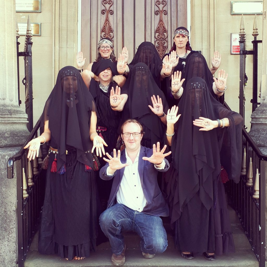 Mark Rees with the Lotus Sisters outside Swansea Museum